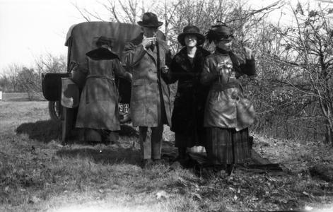 Family packing up a picnic in car