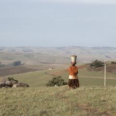 Southern Africa : Domestic Activities : Xhosa woman with pail