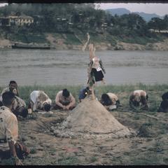 Praying around sand temple