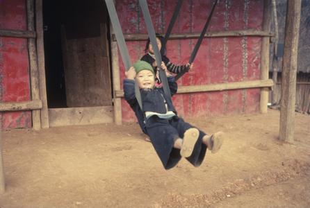Hmong children swinging