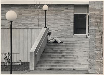 UW Marathon County student studying on steps