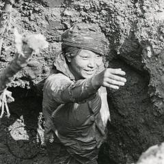 A woman working in a sapphire pit in Houa Khong Province