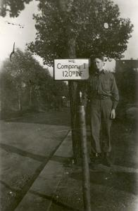 Soldier standing next to the company sign