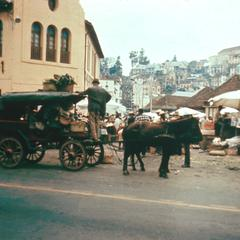 Horse-Drawn Carriage in Front of Variety Store in Zoma Market
