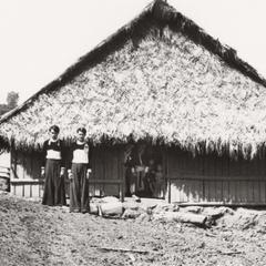 Two White Hmong brothers and house in Houa Khong Province