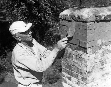 Aldo Leopold fixing chimney at the shack