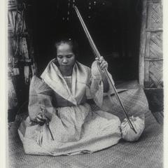 Woman spinning thread, Ilocos Norte, 1920-1925