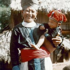 A White Hmong mother with child at the village of Nam Phet in Houa Khong Province