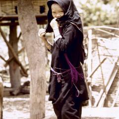 A Lanten girl walks through her village in Houa Khong Province