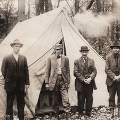 Group of miners by a tent