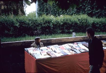 Bookseller at a table