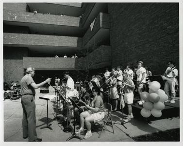 Stout Jazz Band performing outside for students in front of Heritage Hall, Spring 1990
