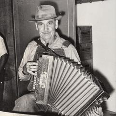 "John ""Happy"" Routar plays accordion"