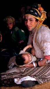 A Nomadic Berber Woman with Baby in  Her Tent
