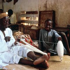 Weaver Preparing Cotton Thread for Weaving