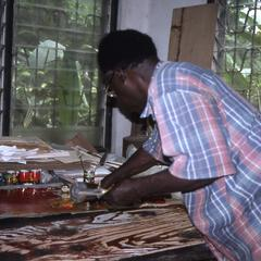 Folarin working with prints