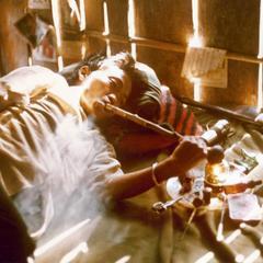 Hmong man smokes opium in a Hmong village in Houa Khong Province