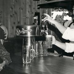Pouring beer in German dress