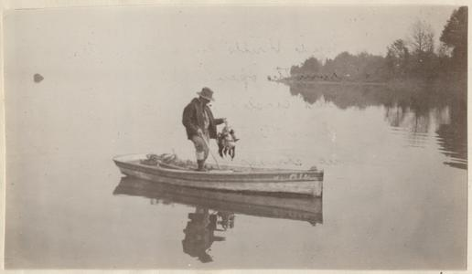 Aldo duck hunting from boat, Wicomico River, Maryland, November 1924