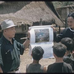 Hmong (Meo) and Inspector of Education with calendar