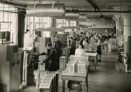 Assembling rocket motor carrying boxes at Aluminum Goods Manufacturing Company