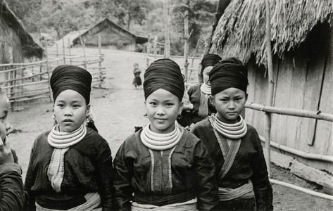 Three Blue Hmong (Hmong Njua) girls stand in their village in the vicinity of Muang Vang Vieng in Vientiane Province
