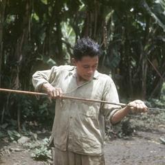Indian making arrow, Palenque Margarita