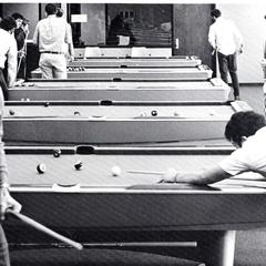 Students shooting pool