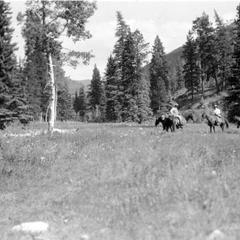Horseback riders on prairie