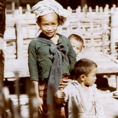 Young girl with her two young brothers in the Lu village of Ta Fa in Houa Khong Province