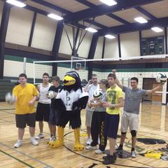 The Falcon mascot with students