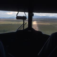 Airplane approaching airstrip