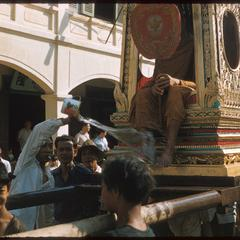 Carrying monk on palanquin