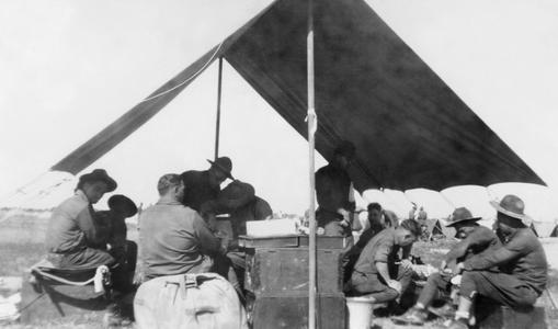 Soldiers of the US Army's 15th Infantry Regiment resting in a tent.
