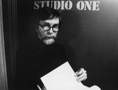 Karl Schmidt at studio door