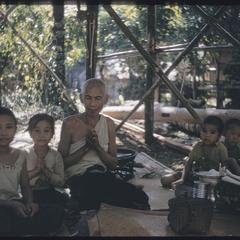 Lao village : ceremony to guard new house from phi (spirits)