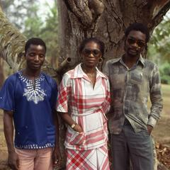 Nike (Komolafe) Afolabi and two others in front of tree