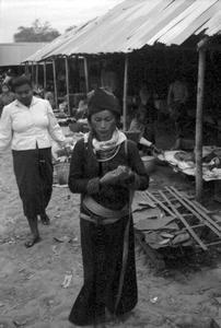 Akha and Lao woman at market