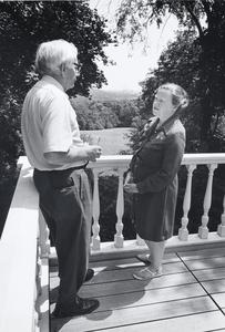 Edwin Young and Phyllis Smart Young stand on a deck
