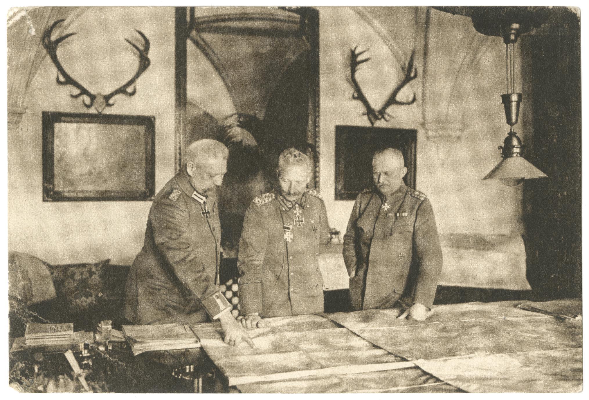 [War leaders study field maps]