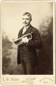 Man holding a cornet