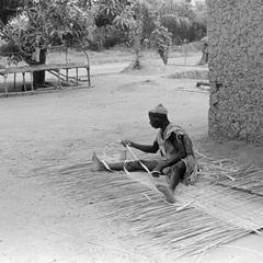 Man Weaving a Mat