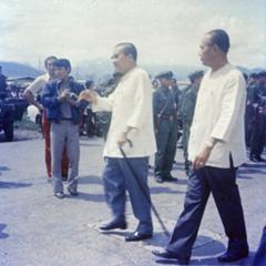 Prince Souvanna Phouma and Phagna Pheng Phongsavan awaiting Prince Souphanouvong at Luang Prabang City airport