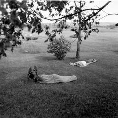 Gus and people in sleeping bags in shack yard