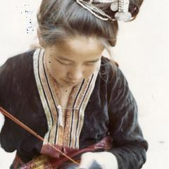 Blue Hmong woman embroiders in a village in northern Thailand