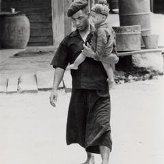 A Yao (Iu Mien) father walks with his son in the town of Nam Kheung in Houa Khong Province