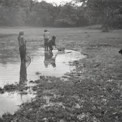 Nyaheun women are fishing in a pond near the village of Nam Nga Teung in Attapu Province