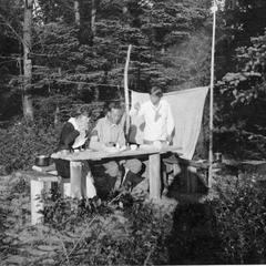 Marie Leopold and others at picnic table at Les Cheneaux