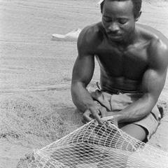 Man Mending Net for Ocean Fishing