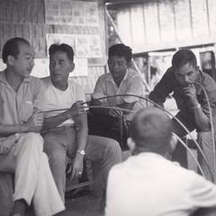 Mr. Autit is seated with Laven villagers in Houei Kong in Attapu Province